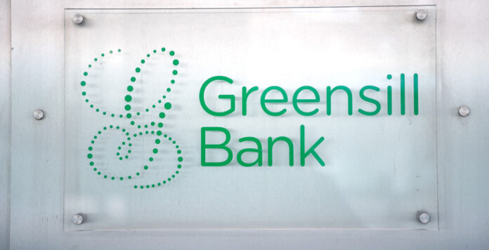 Ein Schild am Eingang der Bremer Privatbank. Die deutsche Finanzaufsicht Bafin hat für die Greensill Bank einen Insolvenzantrag gestellt. Wie konnte es so weit kommen?